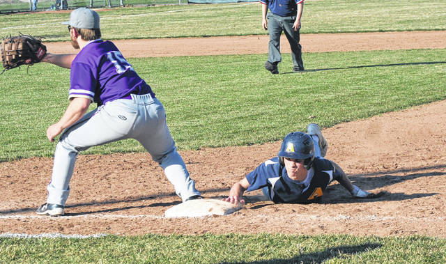 Archbold's Brandon Taylor slides back into first base to avoid being picked off Monday versus Bryan in the NWOAL baseball opener. The Blue Streaks held on for a 5-3 win over the Golden Bears.