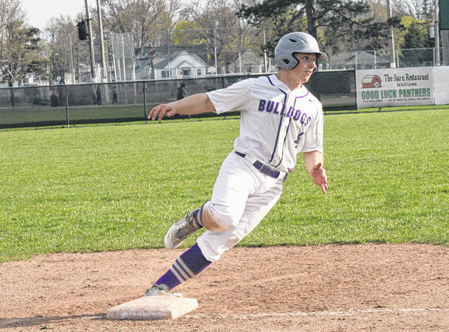 Swanton's Zach Zawodni rounds third before being held up by coach Tim McCarthy during a NWOAL baseball game against Delta Monday. The Bulldogs shut out the Panthers 4-0 for their first league win.