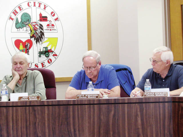 Wauseon City Council members, from left, Jeff Stiriz, Steve Schneider, and Harold Stickley listened Monday to a discussion on street repaving.