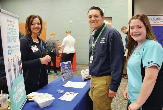 The 5th Annual Job and Career Fair was held recently at Four County Career Center in Archbold, with over 50 area employers on hand for seniors to meet. Over 500 students had the chance to discuss their career options with local businesses and see what opportunities were available to them. Shown speaking with Kari Dominique from the Fulton County Health Center in Wauseon are Trenton Peluso of Evergreen and Janessa Fuller of Holgate. Ellie Cichocki, job placement coordinator, made arrangements for the event.