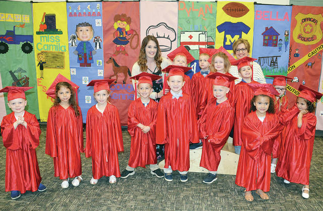 The students at Four County Career Center's Early Childhood Education class recently held preschool graduation for children enrolled during the 2018-19 school year. The children performed favorite songs and fingerplays learned throughout the school year for parents and grandparents in attendance. Pictured are, front, from left, Dylan Boyer of Wauseon, Guiliana Zetter of Toledo, Kennedy Blue of Holgate, Micah Helberg of Napoleon, Blake Schroeder of Bryan, Zachary Norden of Napoleon, Laiklin Evers of Napoleon, Camila Zetter of Toledo – back, from left – preschool instructor Katelyn Flanary, Jordan Inkrott of Delta, Brennan Vandock of Delta, Elowyn Custer of Wauseon, educational aide Jennifer Hutchison, Zane Reed of Napoleon, and Isabella Schoonover of Defiance. The Preschool/Childcare Center is operated in association with the Early Childhood Education program for juniors and seniors.
