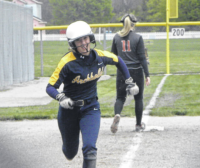 Gabby Nafziger of Archbold races home to tie the game in the bottom of the first inning Monday in a Division III softball district semifinal. The Blue Streaks held on for a 6-4 win, advancing to the district final where they will take on top-seeded Eastwood today at 5 p.m.