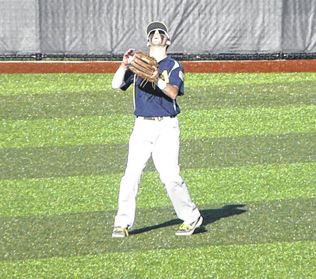 Archbold outfielder Mitch Grosjean waits on a fly ball Thursday versus Otsego in a Division III district semifinal at Defiance. The Blue Streaks would pick up the win over the Knights, 6-5.