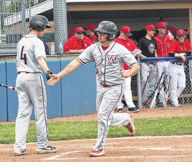 Levi Krasula of Wauseon receives congratulations from teammate Brady Thomas (4) after hitting a solo home run in the top of the fifth inning Saturday versus Bowling Green in a Division II district final at Archbold's Memorial Park. The Indians fell to the Bobcats 8-2.