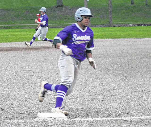 Swanton's Hunter Mix rounds third and heads home to score a run during a game this season. Mix and Michael Lawniczak were selected second team all-district for the Bulldogs.