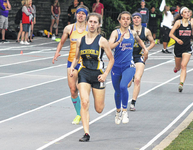 Gwynne Riley of Archbold leads the pack in the 800 meter run during the finals of the Division III Tiffin Regional held at Heidelberg University. She won the 800 and also advanced to state in three relays.