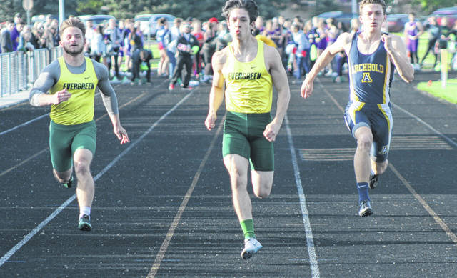 Reece Serna of Evergreen, center, races to the finish in the 100 meter dash Friday at the Northwest Ohio Athletic League Championships in Bryan. He would stake titles in the 100m and 200m.