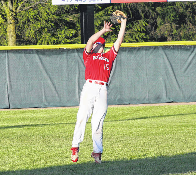Wauseon left fielder Joey Shema goes up for a catch during a Division II district semifinal against Napoleon Thursday. The Indians hung on for a 1-0 victory.