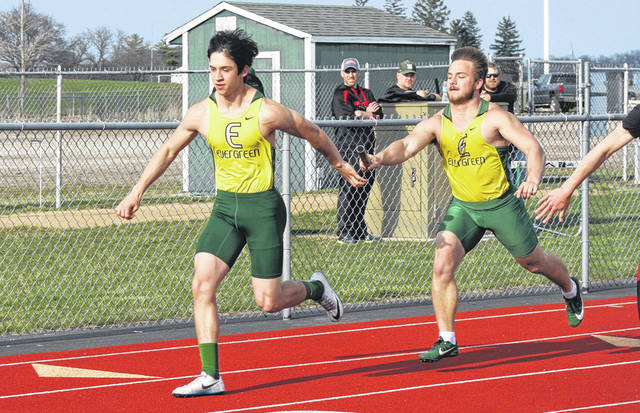 Evergreen's Reece Serna, left, takes the baton from Hunter Vanwert in the 4x200m relay at an earlier meet this season. The Viking boys placed first as a team while their girls took second at the second annual Rupp Invitational held Monday.