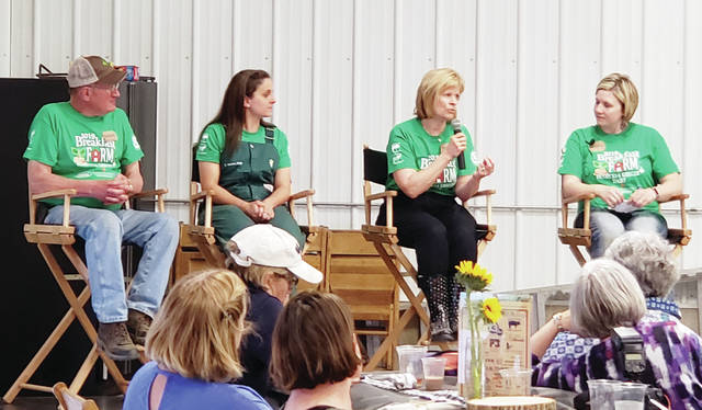 """From left, dairy farmer Richard Henricks, veterinarian Dr. Christine Greiner, dietitian Karen Bakies, and farmer and agriculture teacher Whitney Short took part May 16 in a question and answer session at Ladies Night on the Farm, a precursor to Fulton County Breakfast on the Farm, to be held June 15 on the Henricks and Kreiger dairy farm east of Fayette. """"Ladies Night"""" included a tour of the facilities, a dinner and grazing stations, and relevant discussions on dairy farms and food production practices."""