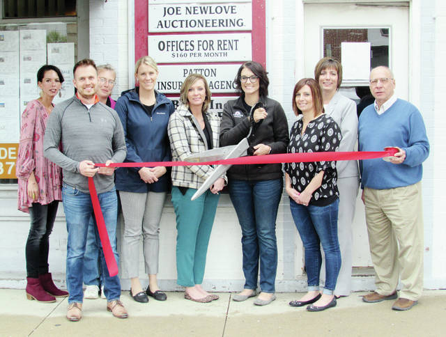 Patten Insurance Agency has opened a second location at 145 S. Fulton St., Suite 5, in Wauseon. Home, auto, business, and life insurance are available by appointment. Owner Karrie Patten did the honors at a ribbon cutting ceremony held Friday. Also pictured are office manager Amanda Lennard, center left, and members of the Chamber of Commerce.