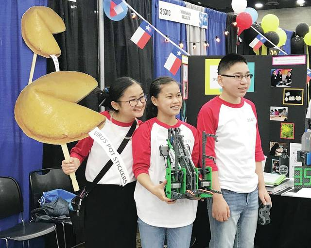 From left, Grace Meyer and Lily and Ty Nofziger at the VEX Robotics World Championship in Louisville, Ky.