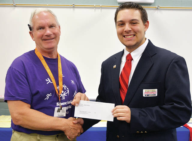 During Chapter Awards Day, the Four County Career Center's Business Professionals of America presented a check for over $890 to Special Olympics organizations in the four-county area. Trenton Peluso, BPA chapter president, left, made the presentation to Randy Barnes, Special Olympics coordinator for Henry County.