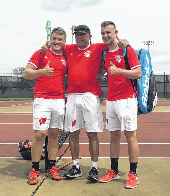 Sam Frank and Tristan Uribes, seen with coach Stan Schmidt, punched their ticket to the state tennis tournament.