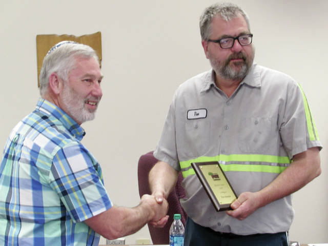 Local business leader Tim Dennis, right was awarded Booster of the Year by the Wauseon Tree Commission member Rick Frey for Dennis's involvement in creating the Indian Hill Trail adjacent to Homecoming Park.