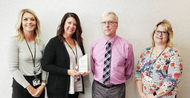Receiving the Ohio BCCP Award are Northwest Region Breast and Cervical Cancer Project staff members, from left, Erica Miller, Christa Bickel, Board of Health President Dr. Keith Lehman, and Jill Precht. Not pictured: Tammy Bialorucki.