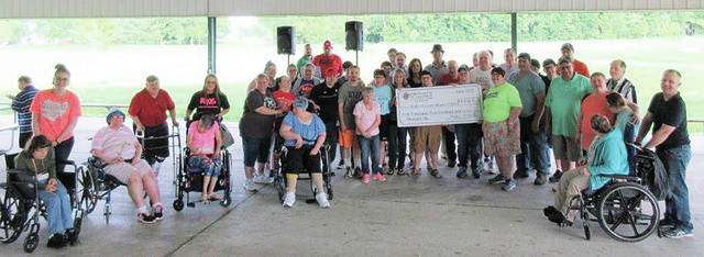 The Fulton County Board of Developmental Disabilities held its 14th Annual Family Picnic on June 11. St. Caspar Catholic Church Knights of Columbus provided the food for the event. The evening also included dancing and caricature drawing. The K of C presented the staff and individuals with a check for $1,500 from the Measure-Up Campaign.