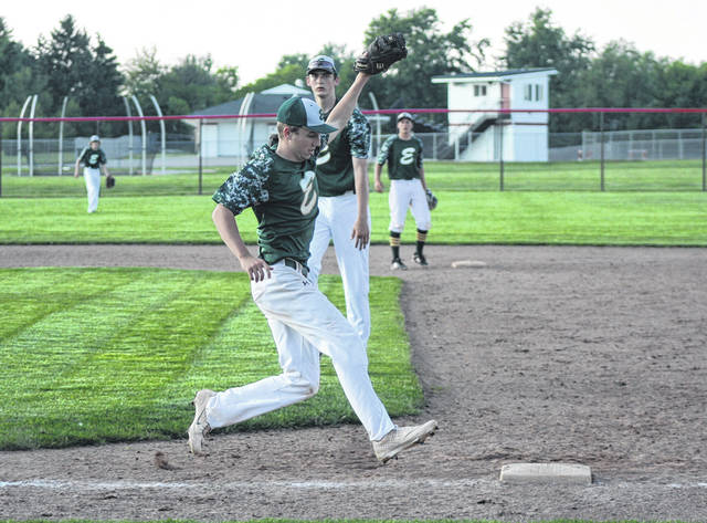 Mason Henricks of Evergreen snags a ball from RJ Shunck while racing to first to record the out during ACME baseball action at Wauseon Tuesday evening. The Vikings would hold on for a 2-1 win.