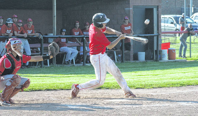 Sam Krasula of Wauseon sends one to left field, getting to second when the ball is dropped Tuesday in ACME baseball against Patrick Henry. The Indians defeated the Patriots 19-9 in six innings.