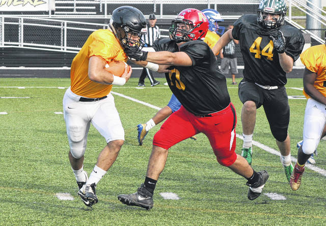 Wauseon's Trevor Rodriguez forces Brad Mendoza of Gibsonburg to the outside on a handoff Friday night during the Northwest Ohio Regional All-Star Football Game in Perrysburg. However, the Black Team would fall to the Gold Team 47-13.