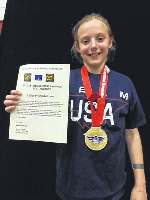 Bethani Tibbs of Wauseon sports her Gold Medal proudly after taking first at the World Karate & Kickboxing Commission National Championships in Detroit Saturday, June 8. She will now compete in the World Championships in Niagara Falls, New York, to be held in November.