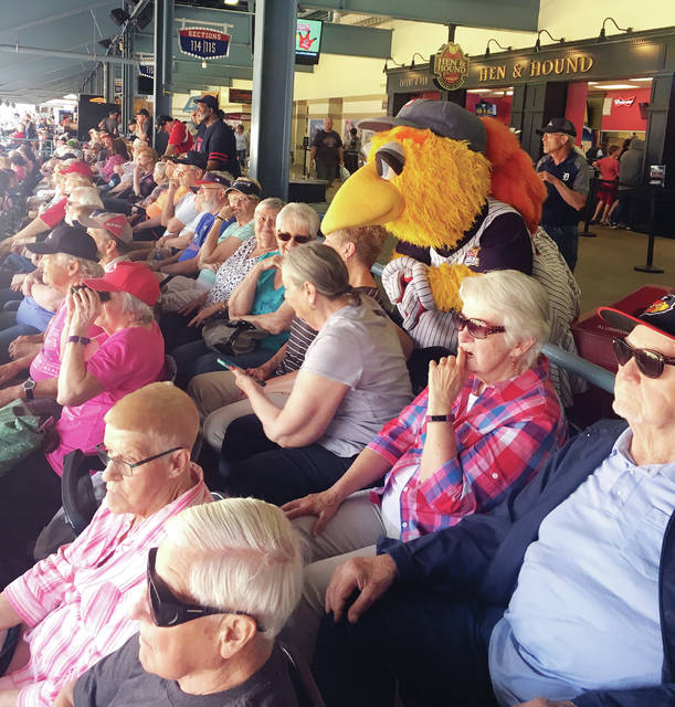 Senior citizens took a day trip through the Fulton County Senior Center on June 20 to watch the Toledo Mud Hens in action. During the game they received a visit in the stands from Muddy the Mud Hen.