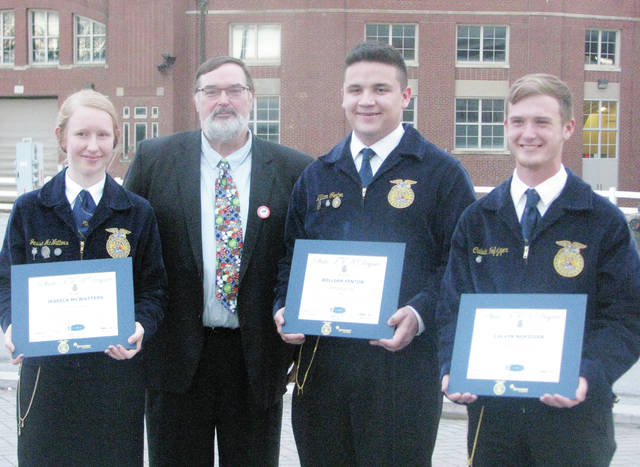 Pettisville FFA members who received State FFA Degrees at the 91st Ohio State FFA Convention are, from left, Jessica McWatters, William Fenton, and Calvin Nofzinger, pictured with advisor John Poulson.