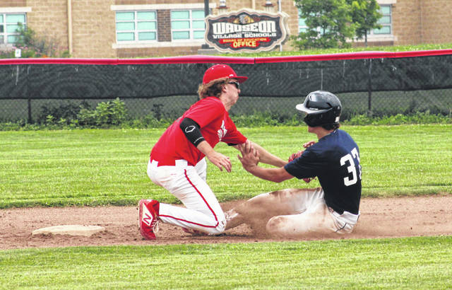 Maddux Chamberlin of Wauseon applies the tag to Tanner Rubinstein of Napoleon who was attempting to steal second in the bottom of the third inning Sunday in the District 2 ACME sectional final. Wauseon would win the sectional with a 5-2 victory over the Wildcats.