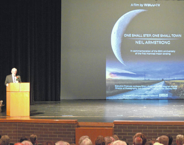 """Anthony Short speaks to a crowd at the Performing Arts Center at Wapakoneta High School prior to the premiere of """"One Small Step, One Small Town- Neil Armstrong."""""""