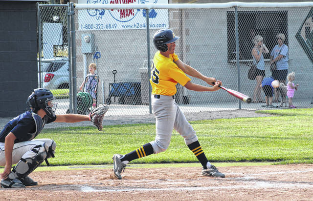Archbold's Dawson Liechty drives in Brandon Taylor in the middle of a four-run first inning Monday at Napoleon in a District 2 ACME sectional tournament game. The Blue Streaks bested the Wildcats 12-1 in five innings to finish sectional runner-up.