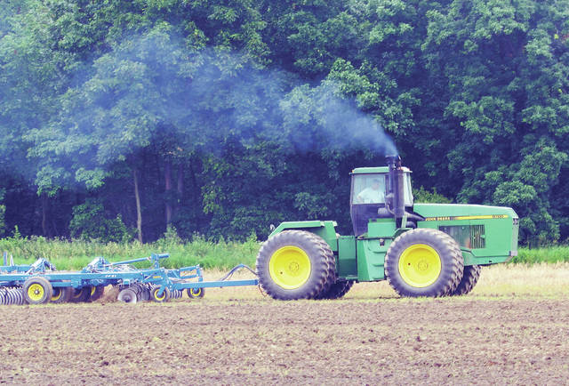 A local farmer was out in his field Tuesday trying to salvage some part of a catastrophic planting season.