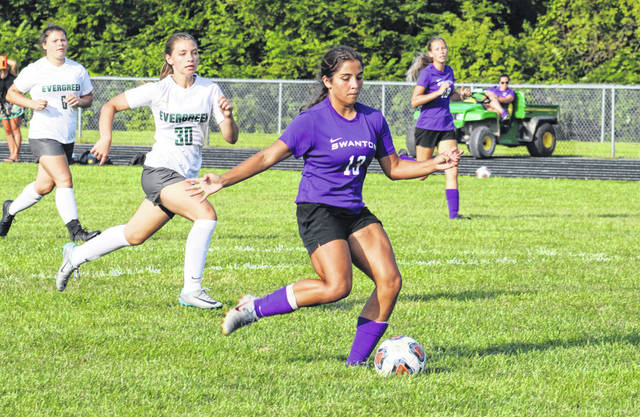 Aricka Lutz of Swanton scores her fifth and final goal in NWOAL action against Evergreen Thursday. The Bulldogs defeated the Vikings 7-2.