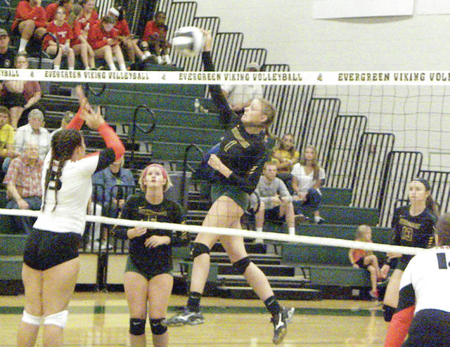 Evergreen's Nicole Brand fires one down the middle during a match last season.