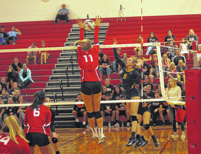 Archbold's Lauren Coressel shoots one over the net from the left side in a match at Wauseon last season. Coressel is one of five letter winners back for the Blue Streaks in 2019.