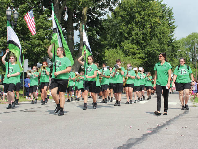 The Delta High School band marches down Main Street in Swanton during the Corn Festival parade on Saturday morning. Delta was one of nine bands in the parade, that also included Swanton, Wauseon, Evergreen, St. John's, Anthony Wayne, Liberty Center, and Montpelier high schools, as well as Adrian College.