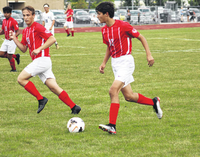 Eli Delgado of Wauseon, right, works the ball up the field Tuesday versus Bryan in NWOAL boys soccer. The Indians and Golden Bears finished in a 0-0 tie.