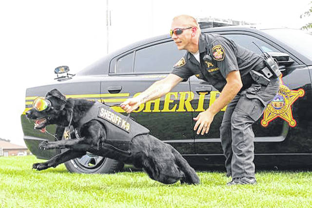 The photo of Deputy Justin Galbraith and K9 Fazzo won an SUV giveaway contest.