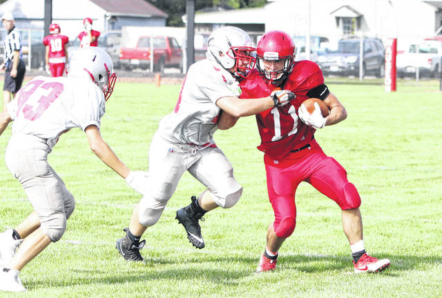 Thomas Leahy of Wauseon tries to break through a tackle Saturday morning in a scrimmage with Bowling Green. The Indians have their last tune-up for the regular season Friday when they welcome Rossford.