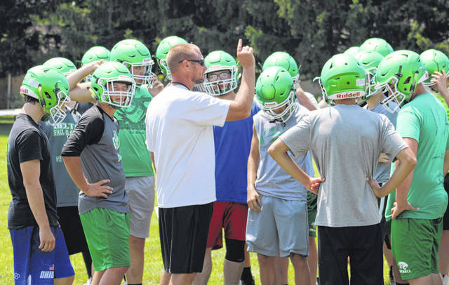 Delta head coach Nate Ruple instructs his team at the beginning of the first two-a-day practice held Thursday afternoon. Ruple returns after a previous stint coaching the Panthers from 2009-12.