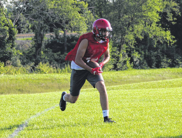 Wauseon's Noah Tester hauls in a pass across the middle during a 7 on 7 drill at Thursday's evening practice. Tester is back for his senior season in 2019.