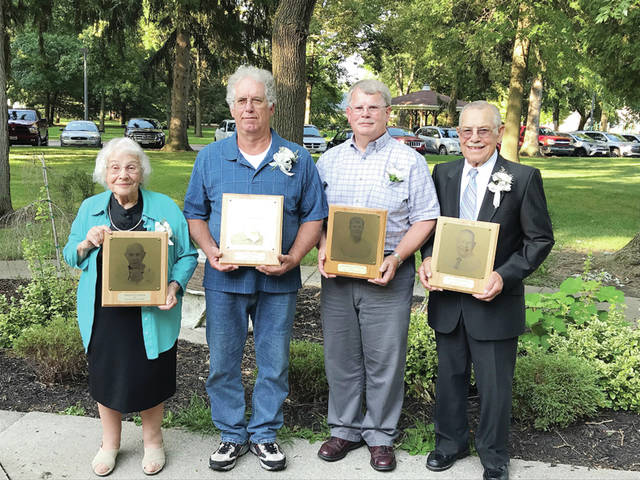 Pictured from left: William Hoops (posthumously, represented by wife Marjorie Hoops), Lee Leininger, Dr. Emerson Nafziger, and William Schmitz.