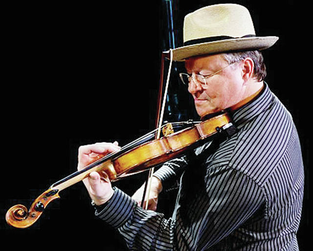 """1978 Wauseon High School graduate Shelby Eicher will be inducted into the National Fiddler Hall of Fame at a ceremony Sept. 27 in Tulsa, Okla. Eicher is a master fiddler, composer, teacher, and recording artist who got his start with the Fulton County Sand Shifters, a band that included his grandmother. Eicher was a member of country legend Roy Clark's band for 15 years and recorded five albums with the band, and appeared multiple times on """"The Tonight Show."""" He is a member of the Tulsa Playboys and Sycamore Swing, a western swing band. Eicher also teaches fiddle, mandolin, and guitar."""