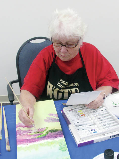 Alicia Glover of Wauseon paid attention to detail during a Friday oil painting class at the Fulton County Senior Center. The center will place an operating levy on the ballot in November.