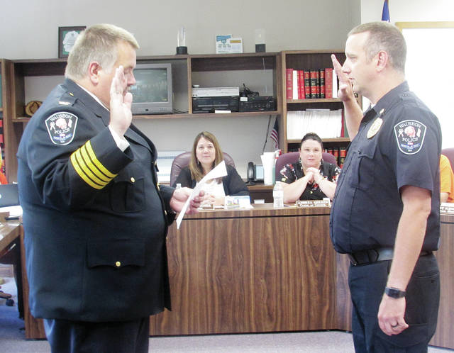 Outgoing Wauseon Police Chief Keith Torbet swore in new chief Kevin Chittenden during the Wauseon City Council meeting held Monday.