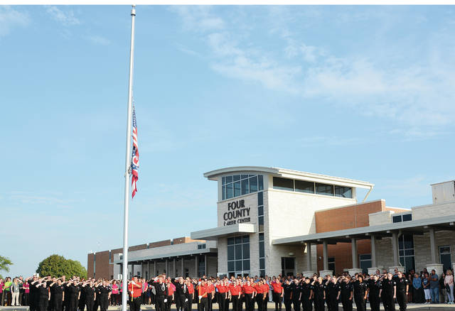 "As a tribute to those who lost their lives, and to acknowledge the 18th anniversary of 9-11, Four County Career Center students from the Fire and Rescue and Law Enforcement and Security Tactics classes, along with instructors Tonya Fisher and Kevin Thomas, held a Remembrance Ceremony in honor of ""Patriot Day."" During the ceremony the ""National Anthem"" was sung by Matthew Zwyer, English instructor. Color Guard Law Enforcement & Security Tactics students lowered the flag to half mast in respect for the day. Representatives from the Archbold police and fire departments, the Bryan, Pioneer, Stryker, and West Unity police departments, the Henry County Sheriff's Office, the Ridgeville Fire Department, the Ohio State Highway Patrol, and U.S. Army recruiters attended."