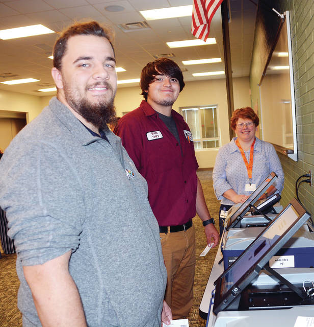 In preparation for the November general election, students at Four County Career Center in Archbold participated in Constitution Day student registration. Melanie Gilders and Liz Stuart from the Fulton County Board of Elections and Mary Detmer from the Henry County Board of Elections spoke to the students about the voting process and let them practice on a voting machine. Shown are, from left, students John Blystone and Brian Yeary, both of Delta, with Gilders.