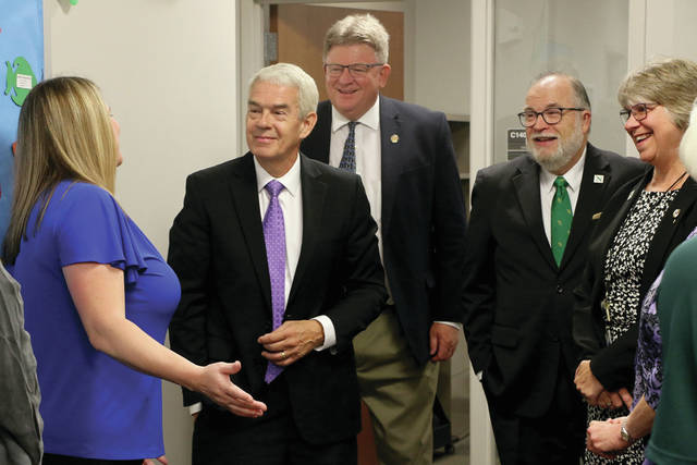 Chancellor Randy Gardner, second from left, learns about the NSCC advising center and its ongoing commitment to helping students create a plan, stick to their plan, and complete their plan. Rep. Jim Hoops, center, Dr. Michael Thomson and Dr. Cindy Krueger, NSCC VP for Institutional Effectiveness & Student Services, far right, listen on.