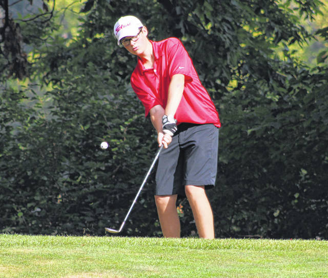 Dylan Grahn of Wauseon with a chip at the 8th hole on Friday during the NWOAL Golf Tournament at Auglaize Golf Course in Defiance. Both he and teammate Andy Scherer tied for second overall, each shooting a 77.