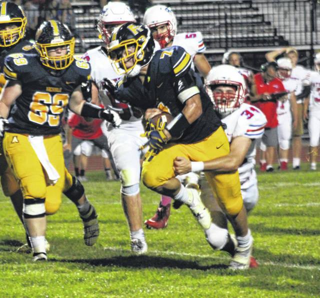 Archbold tailback Caleb Hogrefe runs through a tackle in Friday's NWOAL showdown with Patrick Henry. The Blue Streaks are third in the first edition of the OHSAA computer ratings for Division VI, Region 23.