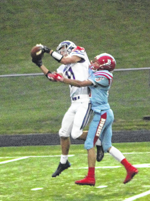 Riley Hensley of Swanton hauls in a pass before racing to the end zone for a touchdown Friday.